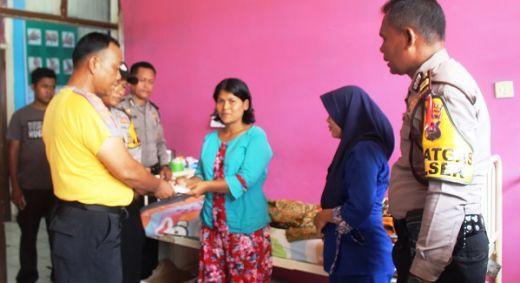 Kapolres Dharmasraya Berikan Bantuan kepada Bocah Penderita Gizi Buruk yang Dirawat di RSUD Sungai Dareh