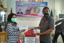 Ringankan Beban Selama Pandemi Covid-19, KONI Padang Beri Bantuan Sembako untuk Mantan Atlet dan Pelatih